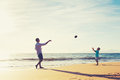 Father And Son Playing Catch Throwing Football Stock Photo - 62122620