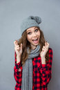Amusing Girl In Scarf And Hat Smiling With Crossed Fingers Royalty Free Stock Photography - 62137097