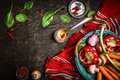 Fresh Organic Vegetables And Seasoning Ingredients In Basket On Rustic Kitchen Table With Spoon And Oil. Royalty Free Stock Image - 62139996