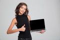 Happy Female Showing Blank Laptop Computer Screen And Thumbs Up Royalty Free Stock Photo - 62145745