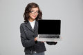 Confident Pretty Female Showing Blank Laptop Computer Screen Royalty Free Stock Photography - 62145917