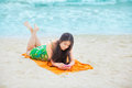 Beautiful Biracial Teen Girl Lying On Tropical Beach With Phone Stock Images - 62164904