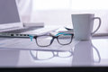 Office Desk With Laptop, Pens, Glasses Stock Photography - 62181092