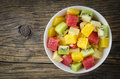 Fresh Fruit Salad On Wooden Table Stock Images - 62188404