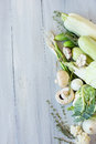 White And Green Vegetables On The Blue Wooden Board. Royalty Free Stock Photo - 62194235