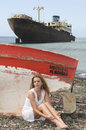 Woman In The Seaside Near An Abandoned Ship Stock Photo - 6228000