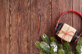 Christmas Gift Box With Headphones And Tree Branch Royalty Free Stock Photography - 62207317