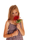 Lovely Girl Holding Up A Red Roses. Stock Photos - 62210623