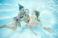 Happy Family Swimming Underwater. Mother, Son And Daughter Having Having Fun In Pool. Stock Photography - 62217452
