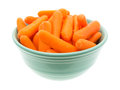 Small Organic Baby Carrots In A Green Bowl Stock Photo - 62226190