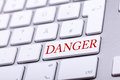 High End Aluminium Keyboard With DANGER Word In Red On It Stock Photos - 62232953
