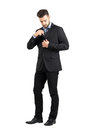 Young Business Man Putting Cellphone In His Suit Jacket Inner Pocket. Stock Photos - 62311253