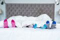 Family Feet Sticking Out From The Blanket Royalty Free Stock Photos - 62325918