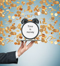 A Hand Holds A Tablet With Alarm Clock. Golden Coins Are Falling Down From The Ceiling. The Concept Of Time Is Money. Stock Photo - 62335970