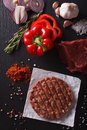 Raw Beef Burger Steak Cutlets With Ingredients Closeup. Vertical Royalty Free Stock Image - 62345906