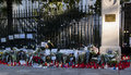 Flowers, Candles And Signs Against Terrorist Attack In Paris, Placed In Front Of French Embassy In Madrid, Spain Stock Photo - 62347010