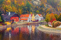 Autumnal Landscape With Coloured House Over River Royalty Free Stock Images - 62351639