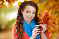Autumn Model, Bright Make Up. Woman On Background Fall Landscape Royalty Free Stock Photo - 62352035