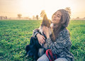 Woman Plays With Her Dog Royalty Free Stock Image - 62356036