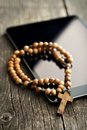 Wooden Rosary Beads With Computer Tablet Royalty Free Stock Photography - 62356877