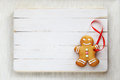 Image Of Gingerbread Man On White Vintage Cutting Board Stock Photos - 62363933