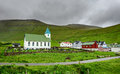Small Village Church With Cemetery In Gjogv, Faroe Islands, Denmark Stock Images - 62364184