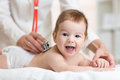 Pediatrician Doctor Examines Baby With Stethoscope Royalty Free Stock Images - 62382149