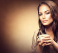 Beautiful Young Woman Drinking Coffee Royalty Free Stock Photo - 62391665