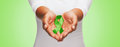 Close Up Of Hands Holding Green Awareness Ribbon Stock Photo - 62398010