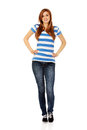 Smiling Teenage Woman With Hands On Hips Stock Photo - 62427770