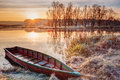 River And Rowing Fishing Boat At Beautiful Sunrise Stock Image - 62453121