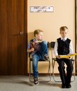 Schoolboys Are Sitting Beside The Principal S Royalty Free Stock Image - 62454016