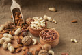 Almonds, Cashew And Hazelnuts In Wooden Bowls On Wooden And Burlap,nuts Stock Photos - 62456133