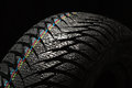 Wet Car Tire On Black Royalty Free Stock Photography - 62459307
