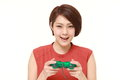 Young Japanese Woman Enjoying A Video Game Stock Photography - 62477882