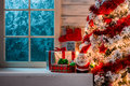 Christmas Scene With Tree Gifts And Frozen Window Stock Photo - 62488510