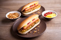 Hot Dog With Gherkin And Onions Stock Photos - 62493503