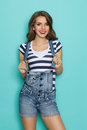 Smiling Woman In Dungarees Royalty Free Stock Image - 62500086