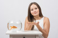 She Asks To Fulfill The Desire To Have A Goldfish In An Aquarium Stock Photo - 62506040