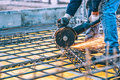 Construction Details With Worker Cutting Steel Bars And Reinforced Steel With Angle Grinder. Filtered Image Royalty Free Stock Images - 62547779