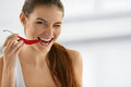 Healthy Woman Eating Spicy Red Chili Pepper. Diet, Food Concept. Royalty Free Stock Photo - 62550045