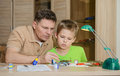 Creating The Model Plane. Happy Son And His Father Are Making Aircraft Model. Hobby And Family Concept. Stock Image - 62551081