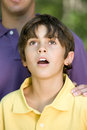 Boy Looking Up In Wonder Stock Image - 62563911