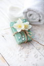 Spa Setting With  Jasmine Blossom, Natural Handmade Soap  And Sea Salt  On White Wooden Table Royalty Free Stock Photos - 62567168