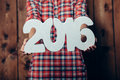 Woman Holding In Hands New Year 2016 Numbers Stock Photography - 62574742