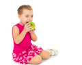 Girl Eating An Apple Royalty Free Stock Photography - 62585067