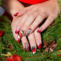 Beautiful Well-groomed Hands Of A Young Girl With Long Fake Acrylic Nails With A Festive Christmas Pattern On The Nails Stock Photo - 62589860