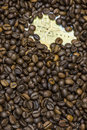 Map Of Ethiopia Under A Background Of Coffee Beans Royalty Free Stock Image - 62633716