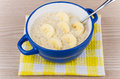 Oatmeal With Bananas And Spoon In Blue Bowl On Napkin Stock Photo - 62667920