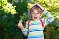 Little Kid Boy With Apple On Way To School Stock Photos - 62671853